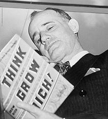 220px-Napoleon_Hill_holding_book_1937
